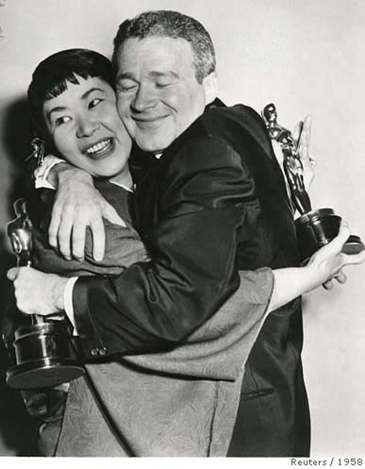 File photo of actors Buttons and Umeki hugging at 30th annual Academy Awards Photo: HO