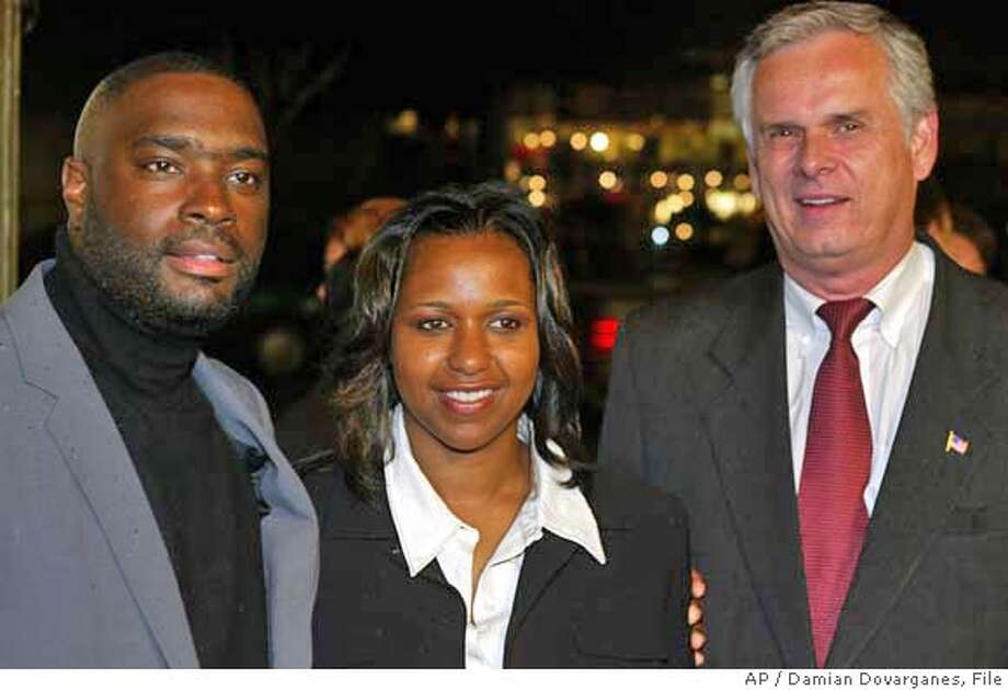 """Screenwriter and co-producer Antwone Fisher, left, and his wife, LeNette Fisher, pose with Los Angeles Mayor James Hahn as they arrive Thursday Nov. 7, 2002, at a screening of Denzel Washington's directorial debut, """"Antwone Fisher,"""" inspired by Fisher's life, at the American Film Institute 2002 opening night at the Cinerama Dome in Los Angeles. (AP Photo/Damian Dovarganes) Photo: DAMIAN DOVARGANES"""