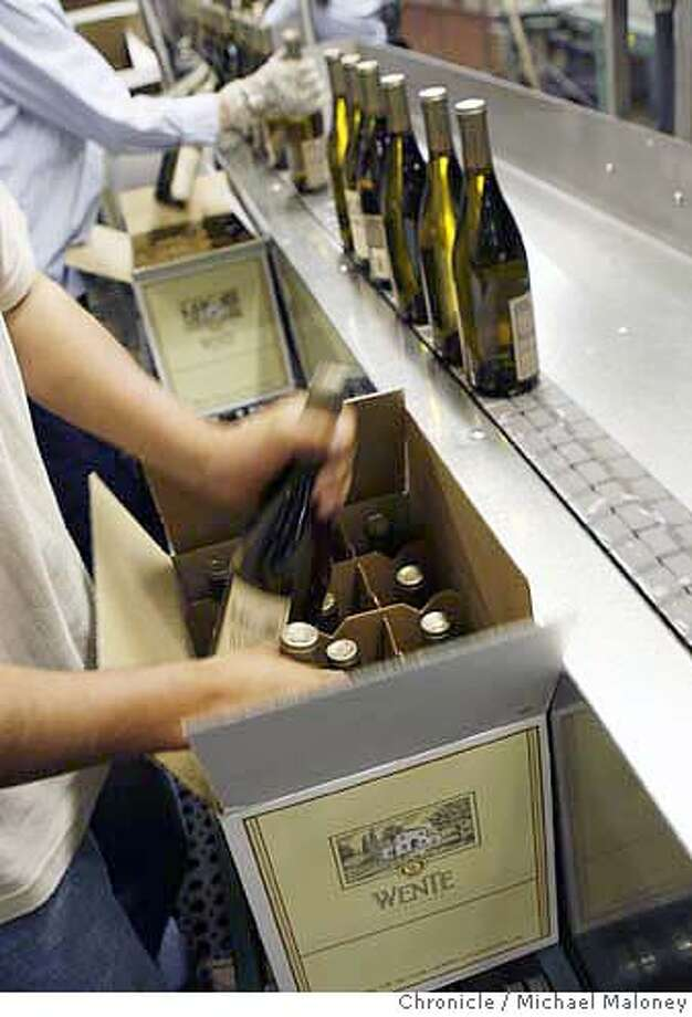 Workers box bottles of Wente chardonnay wine for shipment at Wente Vineyards in Livermore  Eric Wente, chairman of Wente Vineyards in Livermore  Photo by Michael Maloney / San Francisco Chronicle on 7/11/06 in Livermore,CA  ** MANDATORY CREDIT FOR PHOTOG AND SF CHRONICLE/ -MAGS OUT Photo: Michael Maloney