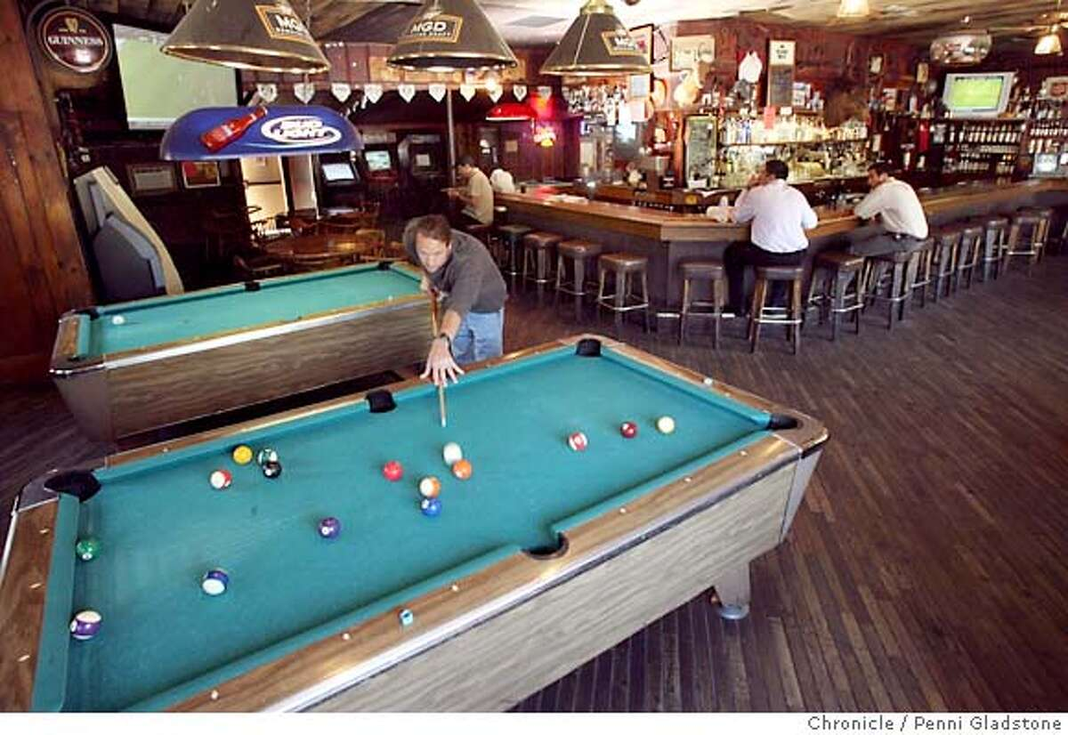 STREETDATE13 Tim Hoover breaks from bar tending to play a bit of pool. The Round Up, a bar in a rustic brown building which was established in 1935. Photo illustration by Penni Gladstone/The Chronicle Photo taken on 7/6/06, in Lafayette, CA.
