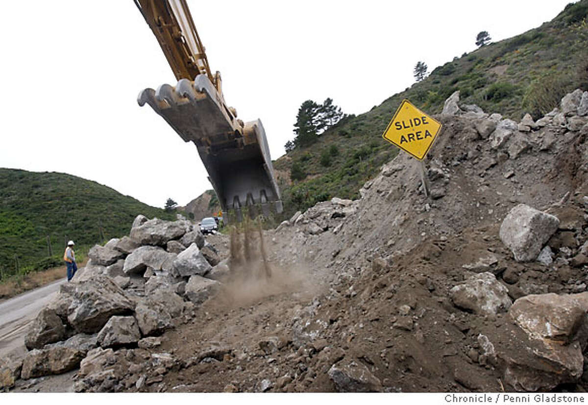 On Hwy 1, this machine moves rocks and boulders off the road on the approach to Devil's Slide on July 13, 2006 in Pacifica.