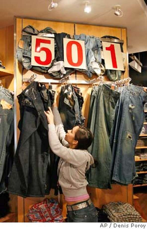** FILE ** Sales associate Ruthie Espanol looks for a pair of jeans at The Original Levi's Store at Horton Plaza in downtown San Diego in a file photo from April 10, 2006. Privately held apparel maker Levi Strauss & Co. said its second-quarter profit jumped 33 percent, mainly due to a tax benefit. (AP Photo/Denis Poroy, File) APRIL 10, 2006 FILE PHOTO Photo: DENIS POROY