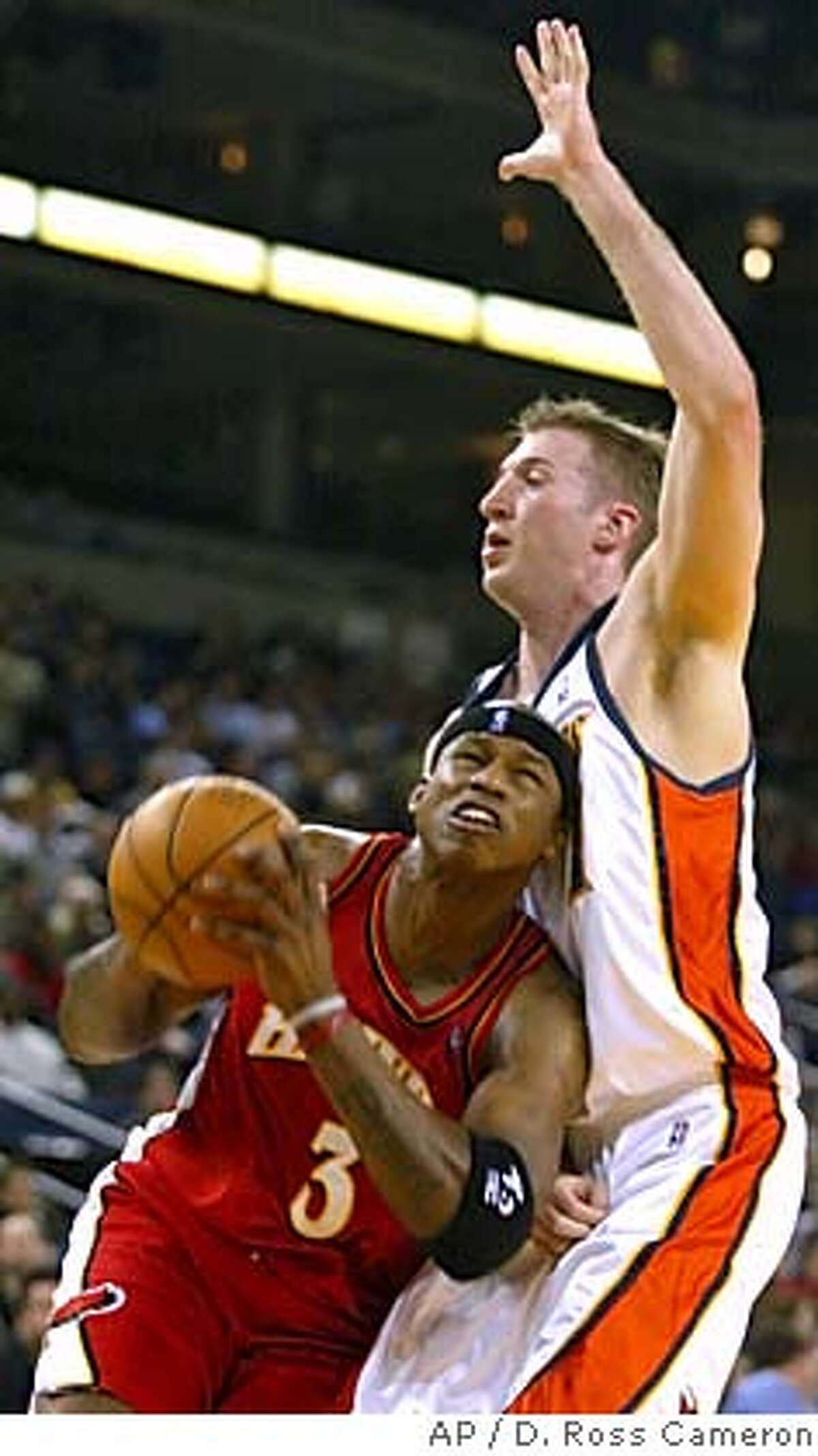 Atlanta Hawks' Al Harrington, left, drives to the basket against Golden State Warriors' Troy Murphy during the first half Wednesday, Feb. 23, 2005, in Oakland, Calif. Murphy returned to the Warriors' lineup after an extended period on the disabled list with a broken left thumb. (AP Photo/D. Ross Cameron) Ran on: 02-24-2005 Troy Murphy, colliding with Al Harrington, finished with 20 rebounds in his first game back after a 10-game injury layoff.