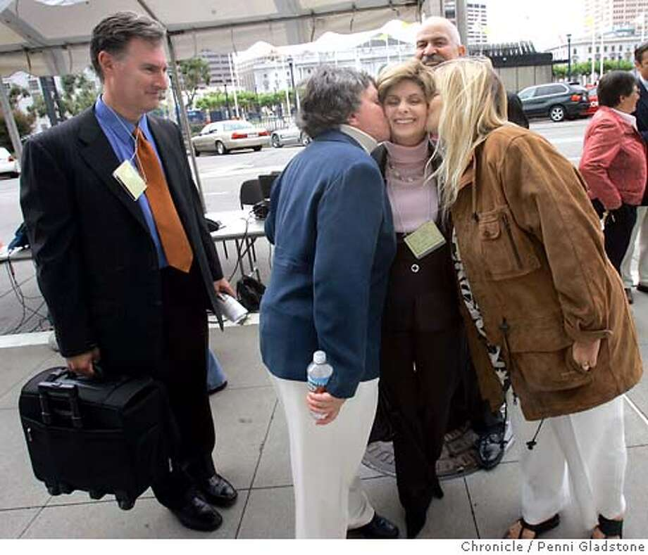 (Allred's law partner) Attorney John West, watches as clients, Robin Tyler and her partner Diane Olson, give their Attorney Gloria Allred a kiss of thanks. Looking on behind Gloria, is Reverand Troy Perry, founder of the Metropolitan Community Church in Los Angeles. They are standing outside the California State Court of Appeal, during a breakas the court takes up the six Same-sex marriage cases. Penni Gladstone/The Chronicle Photo taken on 7/10/06, in San Francisco, CA. Photo: Penni Gladstone
