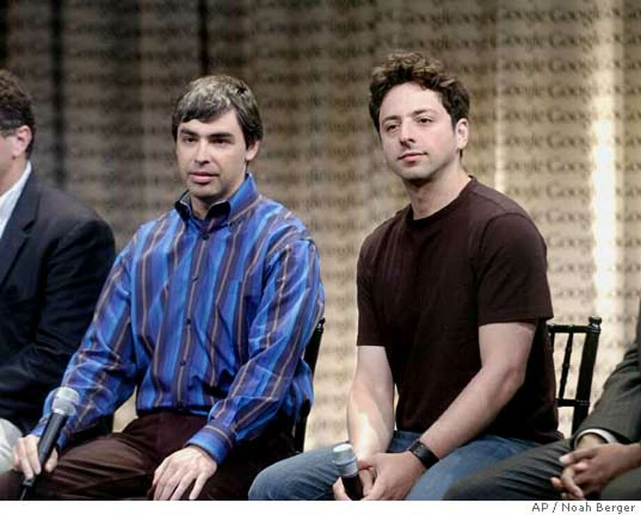 Google co-founders Sergey Brin, right, and Larry Page speak with reporters Wednesday, May 10, 2006, in Mountain View, Calif. Executives discussed the release of Desktop 4, a file-search utility, during Wednesdays event. (AP Photo/Noah Berger) Photo: NOAH BERGER