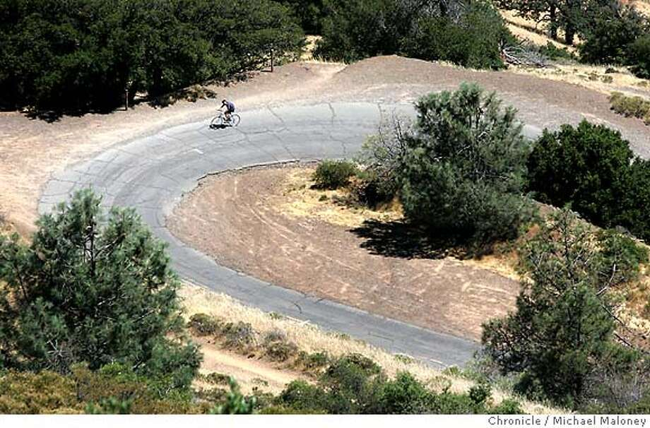 Bicyclist Haun Saussy (cq) of SF rides on Summit Road near the summit on a corner called the Devil's Elbow. The Mount Diablo State Park's popular Summit Road will be closed for much of the rest of the summer for repairs. Some of the work may close the popular road and the mountain's 3,849-foot summit to both bikes and cars.  Contractors will be repaving roads and repairing failing culverts which divert rain-water from the road. This $2.4 million project will take place along the 4.5 mile-long Summit Road. Crews also will do some repairs on North Gate Road the park�s entrance from Walnut Creek.  Photo by Michael Maloney / San Francisco Chronicle on 7/10/06 in Mt Diablo,CA  ** Haun Saussy 415 609-0822 Photo: Michael Maloney
