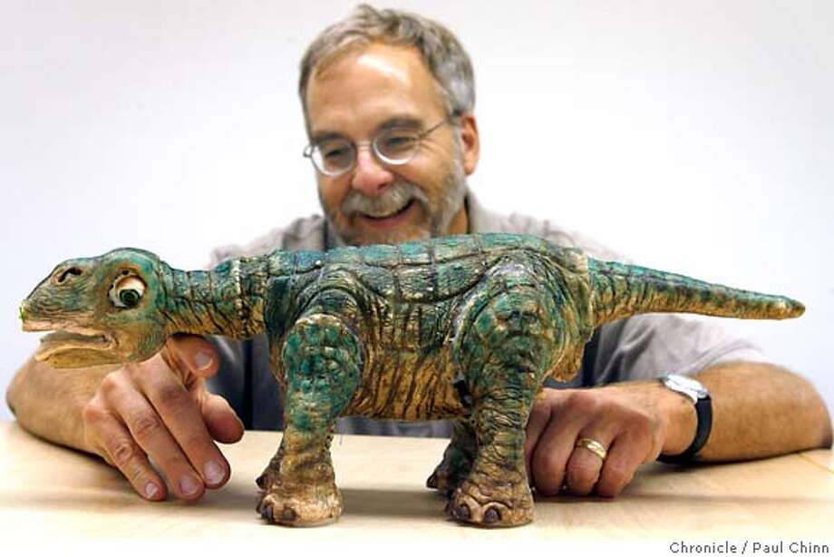 """John Sosoka, chief technology officer at Ugobe, Inc., demonstrates a prototype version of the Pleo dinosaur """"life form"""" in Emeryville, Calif. on Thursday, July 6, 2006. The company plans on selling the autonomous robot for $250 and is aiming for a Christmas season release.  PAUL CHINN/The Chronicle  **John Sosoka MANDATORY CREDIT FOR PHOTOGRAPHER AND S.F. CHRONICLE/ - MAGS OUT Photo: PAUL CHINN"""