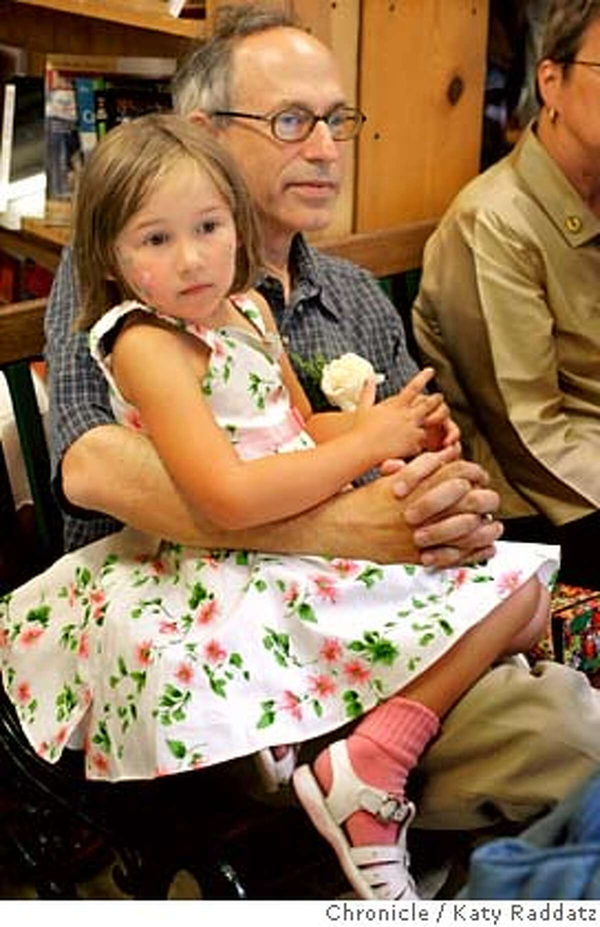 CODYS10_103_RAD.jpg SHOWN: Andy Ross, the current owner of Cody's, holds his 5-yr-old daughter Hayley Ross on his lap while he listens to kind words and stories and farewells from other speakers. Story is about the independent bookstore, Cody's Books, closing its flagship store on Telegraph Ave. in Berkeley. Photo taken on 7/9/06, in Berkeley, CA. (Katy Raddatz/The S.F.Chronicle) **Andy Ross, Hayley Ross Mandatory credit for photographer and the San Francisco Chronicle/ -Mags out