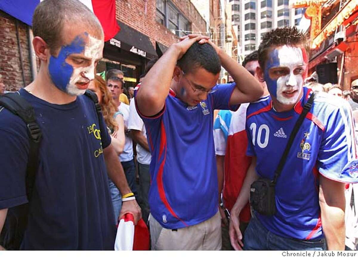 WORLDCUP_BELDEN_10_JMM.JPG Cedric Montfort, 26, of Mountain View, Farid Khezzar, 23, of Sunnyvale, and Boris Henriot, 22, of San Francisco, react to France's World Cup defeat during a live broadcast on a big screen at Belden Alley in San Francisco on July 9, 2006. Italy won 5-3 in penalty kicks after a 1-1 draw after extra time. Event on 7/9/06 in San Francisco. JAKUB MOSUR / The Chronicle