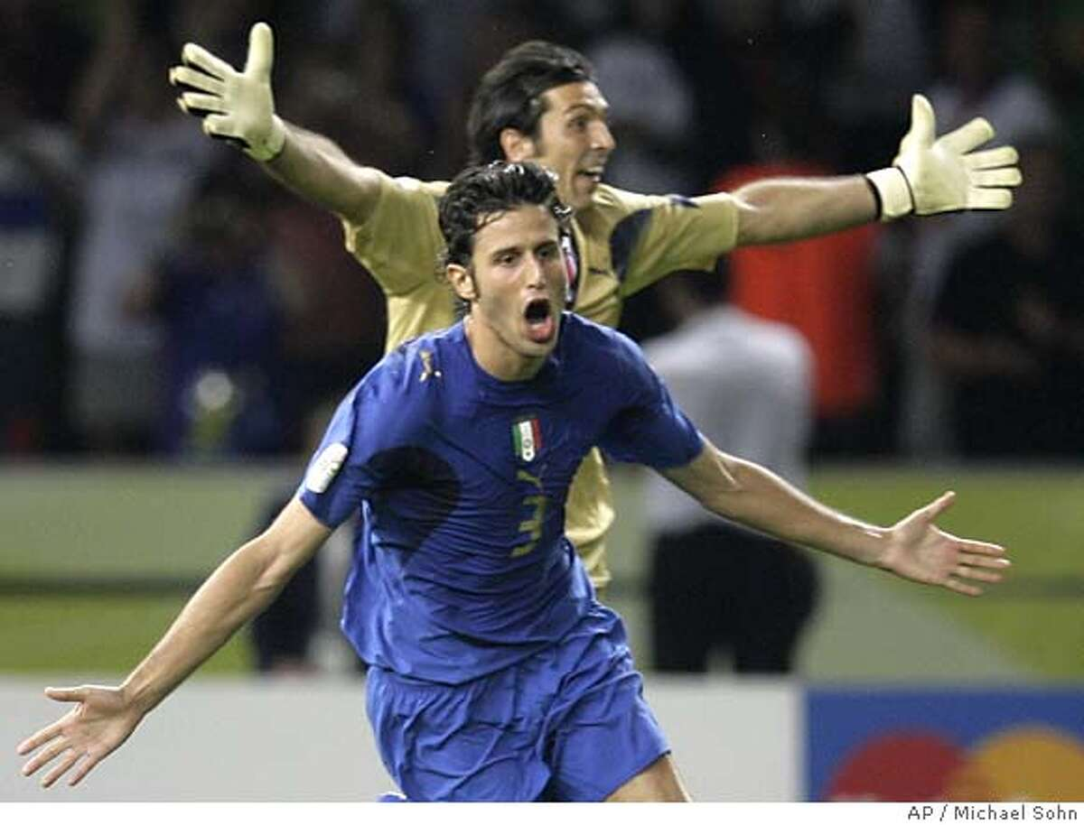 Italy's Fabio Grosso (3) celebrates with teamamte Gianluigi Buffon after scoring the winning penalty kick during the shoot out n the final of the soccer World Cup between Italy and France in the Olympic Stadium in Berlin, Sunday, July 9, 2006. Italy won 5-3 in penalty kicks after a 1-1 draw after extra time. (AP Photo/Michael Sohn) ** MOBILE/PDA USAGE OUT **