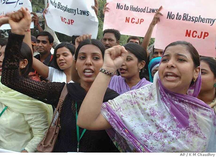 Women activists of a non governmental organization chant slogans during a protest rally against the Hadood ordinance, Saturday, July 8, 2006 in Lahore, Pakistan. Protestors were demanding the repeal the Hadood ordinance. Under the ordinance, which was passed under the military dictatorship of late Gen. Mohammed Zia-ul-Haq in 1979, women can be sentenced to death if found guilty of having sex outside of marriage. It has long been decried as discriminatory against women. (AP Photo/K M Chaudhry) Photo: K M CHAUDHRY