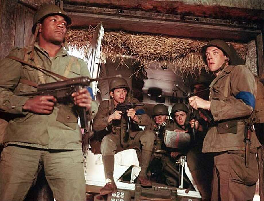 The Dirty Dozen, 1967. Left to right: Jim Brown, Trini Lopez, Stuart Cooper, Colin Maitland, Donald Sutherland.  Ran on: 07-09-2006  Trini Lopez as Pedro Jiminez in &quo;The Dirty Dozen&quo;: On Frank Sinatra's advice, he arranged for his character to be the first one killed off so he could get back to his music career. Photo: MGM