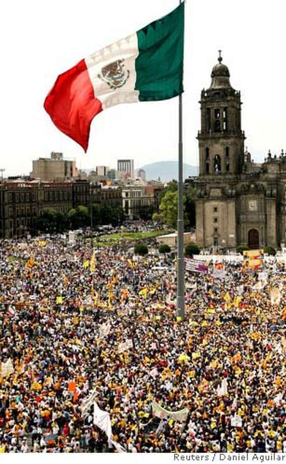Thousands of supporters of Andres Manuel Lopez Obrador attend a rally to protest against the result of last weekend's election in Mexico City's Zocalo square July 8, 2006. REUTERS/Daniel Aguilar (MEXICO)  Ran on: 07-09-2006  Supporters of Andres Manuel Lopez Obrador, below right, chant &quo;Fraud!&quo; in Mexico City's Zocalo. Photo: DANIEL AGUILAR