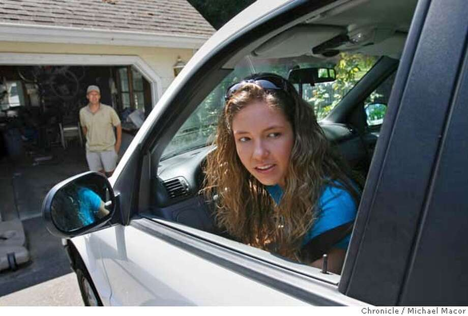 """bigmother_021_mac.jpg Paige White, 17, drives her family vehicle with the """"Car Chip"""" installed. Later her father can remove the device and download information onto his computer showing, miles driven, car speeds, RPM's and even how fast the car was travelling every 5 seconds. Her father, Bill White watches as she pulls out of the garage. Story about the technology parents are using to track their kids, from GPS-enabled cell phones that show their whereabouts, to Internet monitoring software that lets parents read their kids' e-mails and IMs from work to car devices that show how fast they drive, whether they've made a sharp turn or stopped too fast. Los Gatos resident Bill White has a Car Chip installed in the car driven by his 17-year-old daughter Paige. Event in, Los Gatos, Ca, on 6/24/06. Photo by: Michael Macor / San Francisco Chronicle Mandatory credit for Photographer and San Francisco Chronicle / Magazines Out Photo: Michael Macor"""