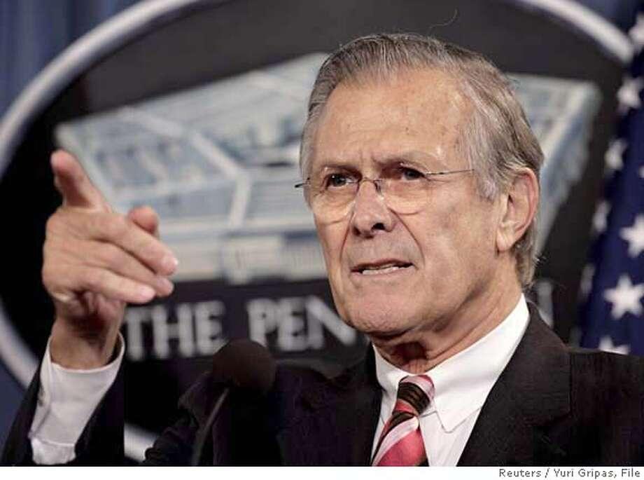 U.S. Secretary of Defense Donald Rumsfeld speaks at a news confernce Photo: YURI GRIPAS