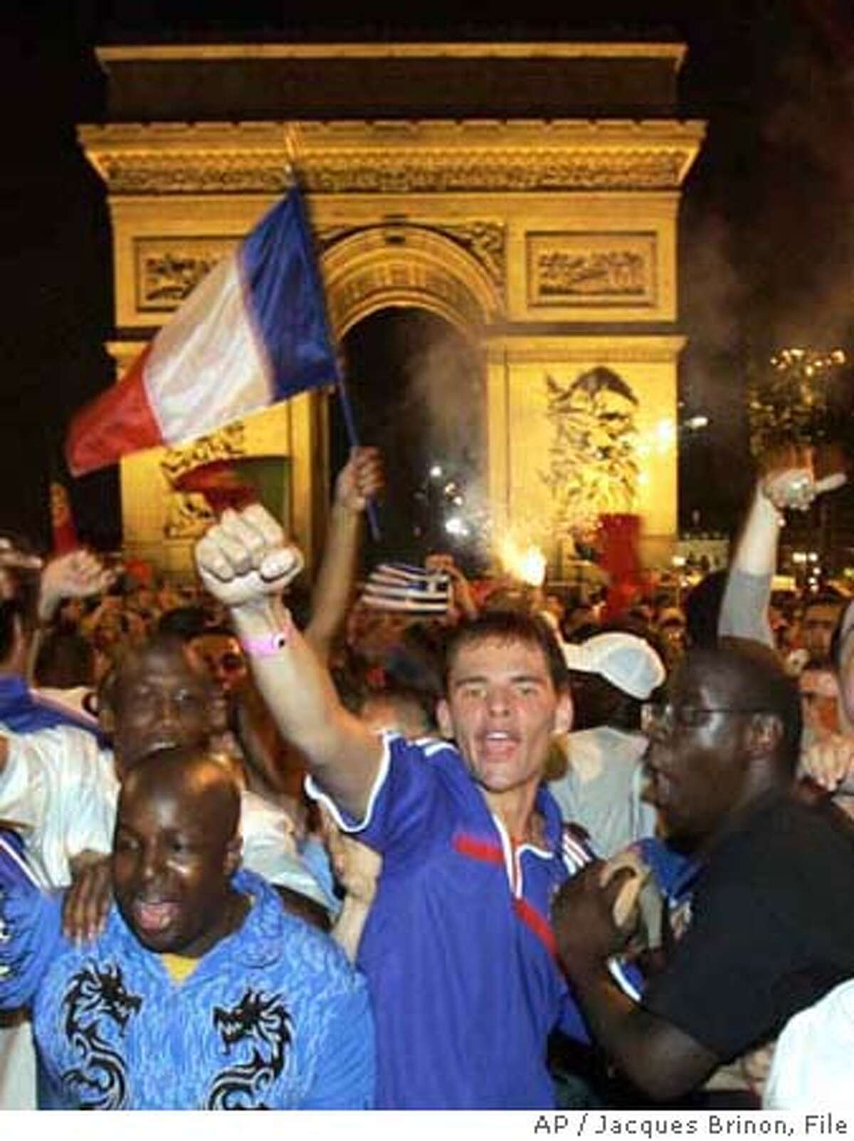 FILE -- People celebrate on the Champs Elysees avenue after the quarterfinal match France against Brazil, Saturday July 1, 2006 in Paris. As France braces for a showdown against Italy in Sunday's soccer World Cup final, the government hopes a resurgence of pride in Les Bleus can also boost economic confidence. But experts say the evidence that sporting success can have lasting economic impact is mixed. (AP Photo/Jacques Brinon) FILE