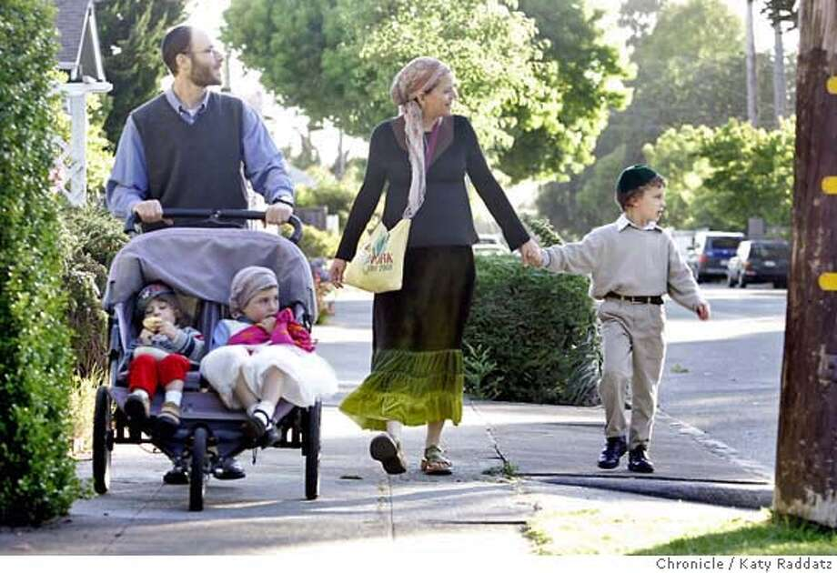 "ERUV_204_RAD.jpg  SHOWN: The Schweig family walks from their home to the synagogue to celebrate the beginning of Sabbath. L to R: Dad (pushing stroller) is Muni Schweig, in stroller: Raanan Schweig (age 2.5), Nava Schweig (age 5), Mom is Tania Schweig holding the hand of oldest son Yonim Schweig (age7). The Schweig family are orthodox Jews, and are very impacted by the symbolic boundary called an eruv. Story is about orthodox Jews in Berkeley created an eruv, which is a symbolic boundary around their community that liberates them from prohibitions against ""carrying"" on the Sabbath. Strict orthodox Jews are not allowed to carry ANYTHING on the Sabbath--keys, babies, etc.--this impacts particularly women, who do most of the child care.  Photo taken on 6/30/06, in San Francisco, CA.  (Katy Raddatz/The S.F.Chronicle  **Muni Schweig, Tania Schweig, Nava Schweig, Yonim Schweig, Raanan Schweig, Sabbath, eruv Mandatory credit for photographer and the San Francisco Chronicle/ -Mags out Photo: Katy Raddatz"