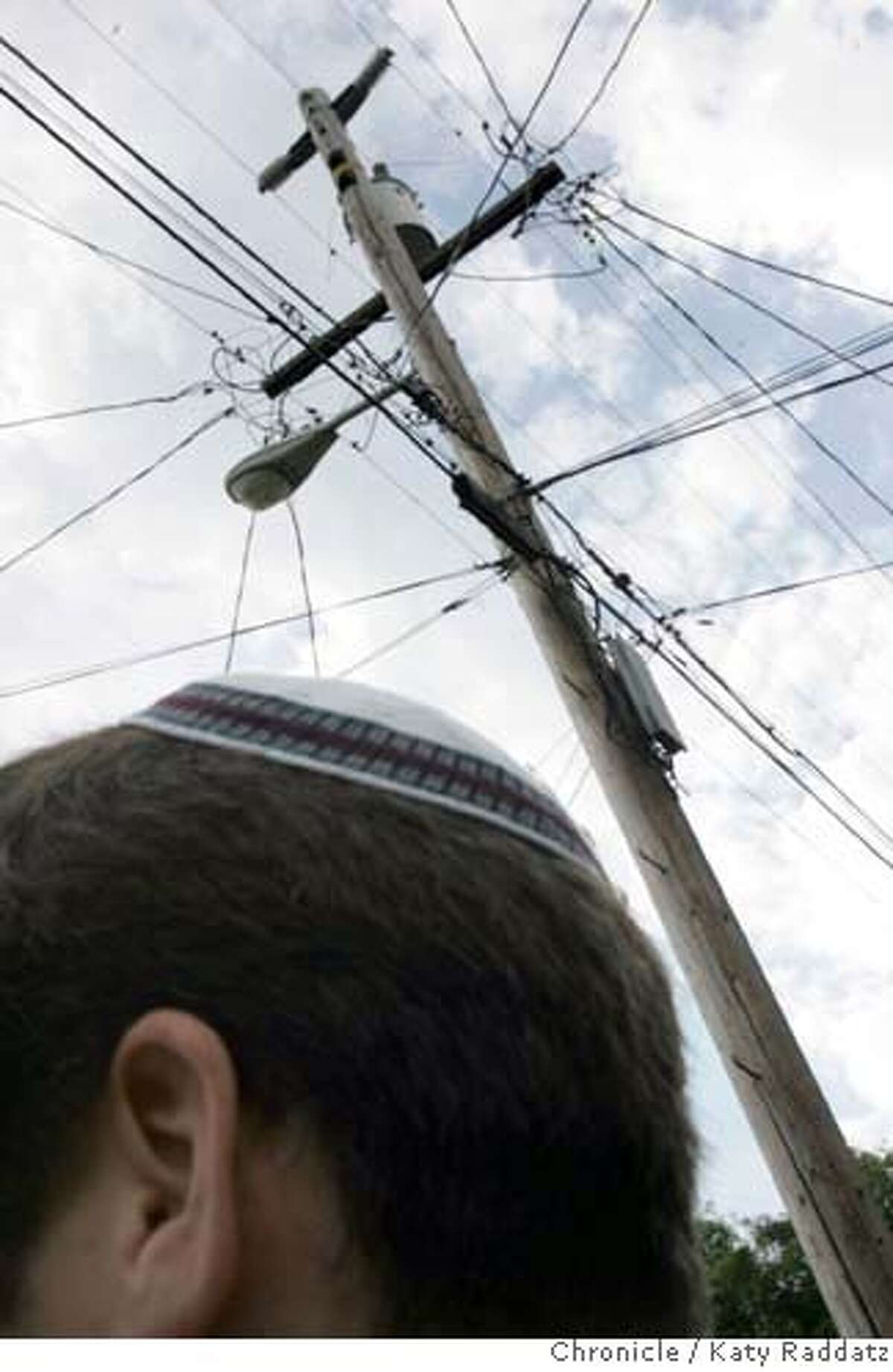 ERUV_113_RAD.jpg SHOWN: A power pole on Cains St. in Berkeley which forms part of the symbolic boundary called an eruv. Rabbi Yair Silverman, the rabbi of Congregation Beth Israel in Berkeley, whose head is seen here, had the idea to create the eruv from power poles and BART tracks an other existing structures. Story is about how orthodox Jews in Berkeley created an eruv, which is a symbolic boundary around their community that liberates them from prohibitions against