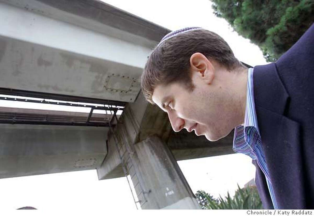 ERUV_005_RAD.jpg SHOWN: Rabbi Yair Silverman, the head of Congregation Beth Israel, at the BART tracks that form part of the symbolic boundary called an eruv, which liberates orthodox Jews from the prohibition of