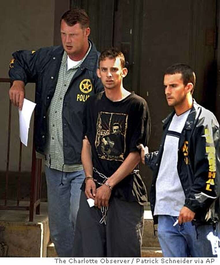Steven D. Green, center, a 21-year-old former soldier who was discharged from the Army, is escorted by U.S. Marshalls, from the federal courthouse in Charlotte, N.C., Monday morning, July 3, 2006. Federal prosecutors have charged Green, a veteran of the Iraq war, with murder and rape Monday following an investigation into the killing of an Iraqi woman and members of her family. (AP Photo/The Charlotte Observer / Patrick Schneider) ** ADDS TV OUT RESTRICTION; MANDATORY CREDIT, INTERNET OUT, MAGAZINES OUT, , TV OUT ** ADDS TV OUT RESTRICTION; MANDATORY CREDIT, INTERNET OUT, MAGAZINES OUT, , TV OUT