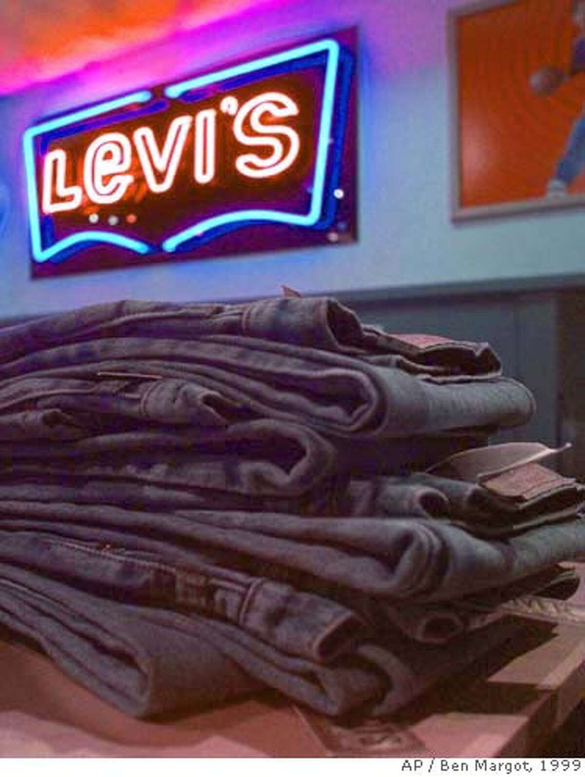 Levi's blue jeans await sale Monday, Feb. 22, 1999, in San Francisco. Levi Strauss & Co. has announced it will close 11 of its 22 North American plants and lay off about 5,900 employees as the jeans maker struggles with slumping sales. (AP Photo/Ben Margot). ALSO RAN 06/21/2000, 12/28/2000, 9/20/2001 CAT