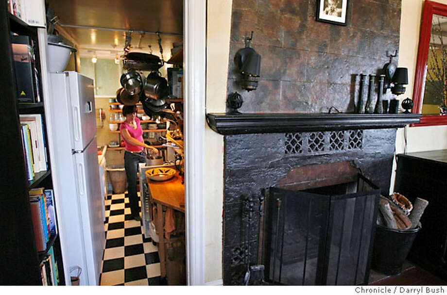 Julie Queen cooks in her small but well organized kitchen which is step down next to her fireplace in her living room, inside her apartment in San Francisco, CA on Wednesday, July 05, 2006. shot: 7/5/06  Darryl Bush / The Chronicle ** Julie Queen (cq) Photo: Darryl Bush