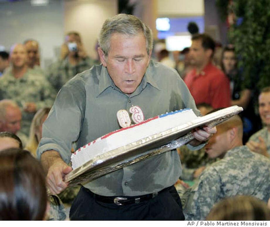 George W. Bush Photo: PABLO MARTINEZ MONSIVAIS