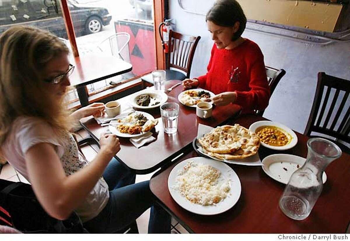 bargain06pakwan_0034_db.JPG Vivien Chung of San Francisco, left, and Jahnavi Anderson of Santa Cruz enjoy food at Pakwan a Pakistani Indian food restaurant on 16th Street in San Francisco, CA on Wednesday, June 28, 2006. shot: 6/28/06 Darryl Bush / The Chronicle ** Vivien Chung, Jahnavi Anderson (cq)
