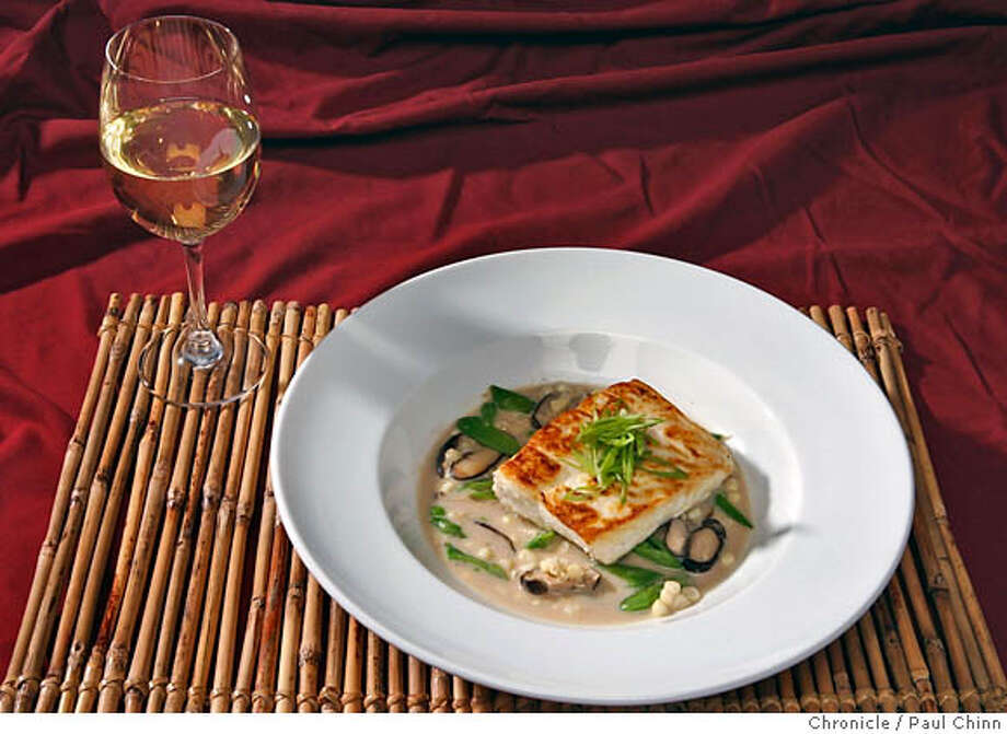 Fish in a coconut-miso broth served with a Carneros chardonnay in San Francisco, Calif. on Thursday, June 29, 2006.  PAUL CHINN/The Chronicle  STYLED BY AMANDA BOWMAN MANDATORY CREDIT FOR PHOTOGRAPHER AND S.F. CHRONICLE/ - MAGS OUT Photo: PAUL CHINN