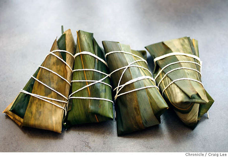 ZUNGZI21_087_cl.JPG  Zungzi, pyramid-shaped sticky rice dumpling wrapped in banana leaves. Step by step photo of how they are made.  Craig Lee / The Chronicle MANDATORY CREDIT FOR PHOTOG AND SF CHRONICLE/ -MAGS OUT Photo: Craig Lee