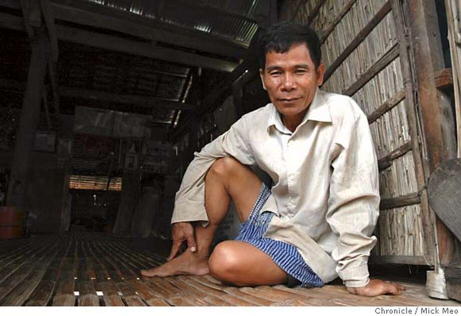 KHMER  Pix for foreign 1344...Picture of Huy Him, former Khmer Rouge executioner, today at his home. The first formal stage of a trial for crimes against humanity and genocide begins on Monday with the swearing in of judges. Senior Khmer Rouge leadership are being tried. By Nick Meo in Cambodia on 00855 11613276  BY NICK MEO/SPECIAL TO THE CHRONICLE Photo: NICK MEO