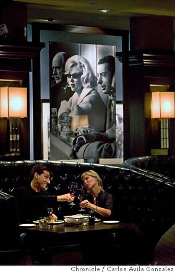 WHATS05_072_CAG.CR2  Justin Press of San Francisco, and Katherine Dunn of Sausalito, enjoy a drink at the new restaurant Joe DiMaggio's Italian Chophouse in San Francisco, Ca., on Tuesday, June 27, 2006. This restaurant plays homage to DiMaggio's life, and serves a classic Italian menu in San Francisco, Ca.'s North Beach neighborhood.  Photo by Carlos Avila Gonzalez/The San Francisco Chronicle  Photo taken on 6/27/06, in San Francisco, Ca, USA  **All names cq (source) MANDATORY CREDIT FOR PHOTOG AND SAN FRANCISCO CHRONICLE/ -MAGS OUT Photo: Carlos Avila Gonzalez
