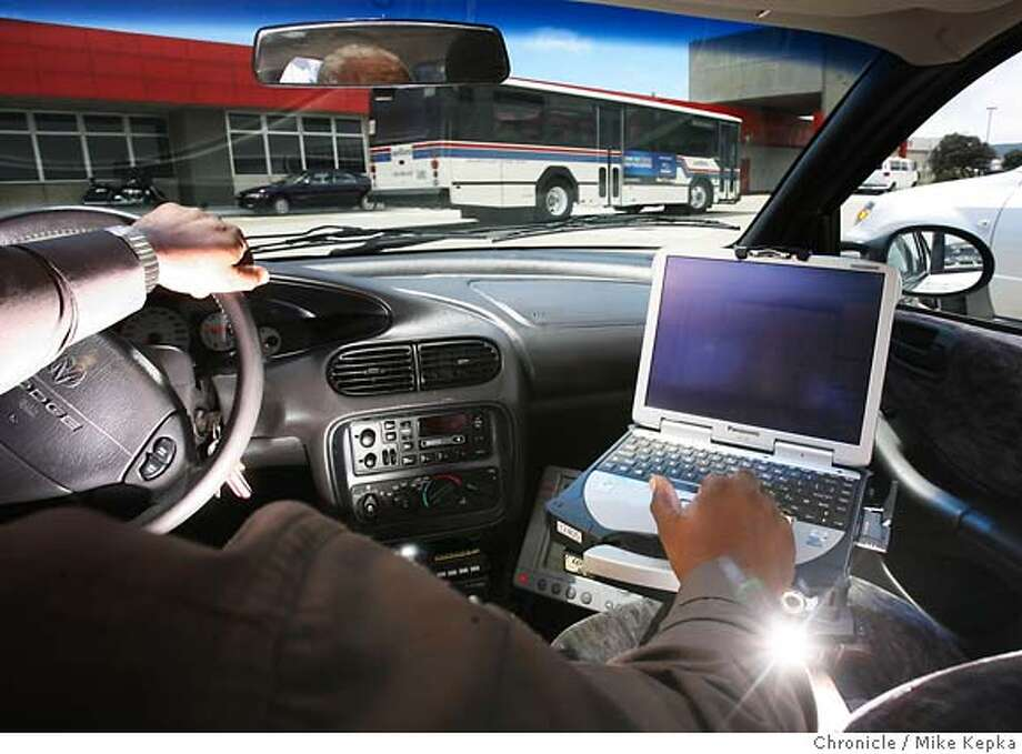 aircard03002a_mk.JPG  Bus Transportation Supervisor, Cornelius Wise demonstrates the operation of his in-car GPS tracking system.  SamTrans has installed GPS tracking systems on their buses and their supervisors have the ability to monitor their drivers from the road using wireless equipped laptops. Friday June 30, 2006. Mike Kepka / THe Chronicle Cornelius Wise (cq) from the source MANDATORY CREDIT FOR PHOTOG AND SF CHRONICLE/ -MAGS OUT Photo: Mike Kepka