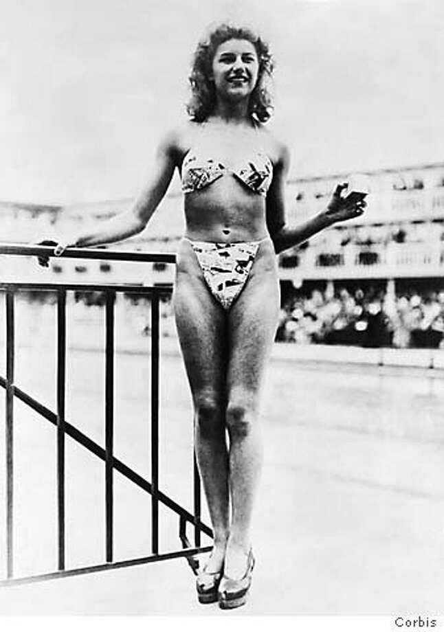 Woman Modeling the First Bikini Photo: Xx