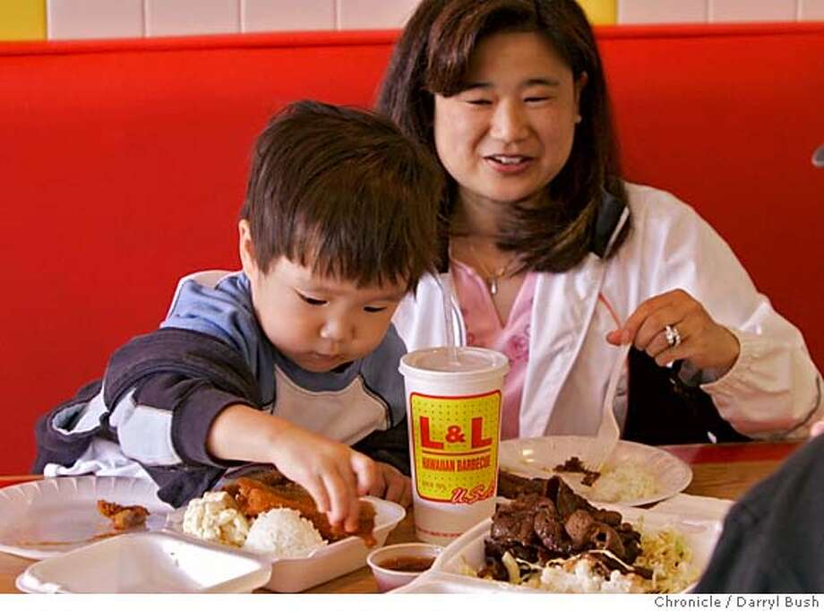 "hawaii03_0051_db.JPG  Taylor Wong, 2, with mother Holly Wong, of San Francisco, begins to eat his ""chicken katsu""at the L & L Hawaiian Barbecue restaurant in San Bruno, CA on Saturday, July 01, 2006. shot: 7/1/06  Darryl Bush / The Chronicle ** Taylor and Holly Wong (cq) ph. 415-759-7282 MANDATORY CREDIT FOR PHOTOG AND SF CHRONICLE/ -MAGS OUT Photo: Darryl Bush"
