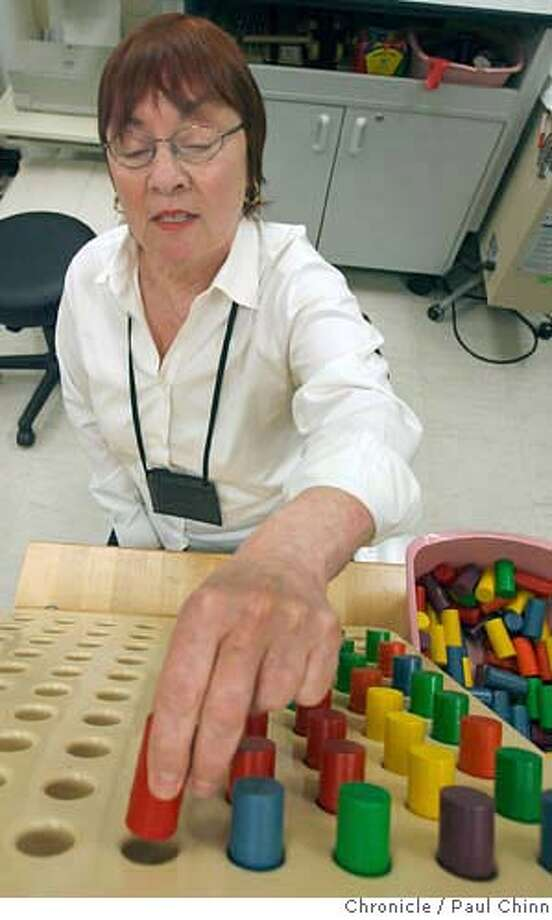 Elaine Cain performs an exercise designed to improve dexterity and endurance for her injured wrist during a therapy session at the occupational therapy clinic at SF General Hospital in San Francisco, Calif. on Thursday, June 29, 2006. Cain has been injured and out of work since May and does not have any health insurance. Mayor Gavin Newsom is proposing a plan to provide health insurance to all of the city's uninsured residents.  PAUL CHINN/The Chronicle  **Elaine Cain MANDATORY CREDIT FOR PHOTOGRAPHER AND S.F. CHRONICLE/ - MAGS OUT Photo: PAUL CHINN