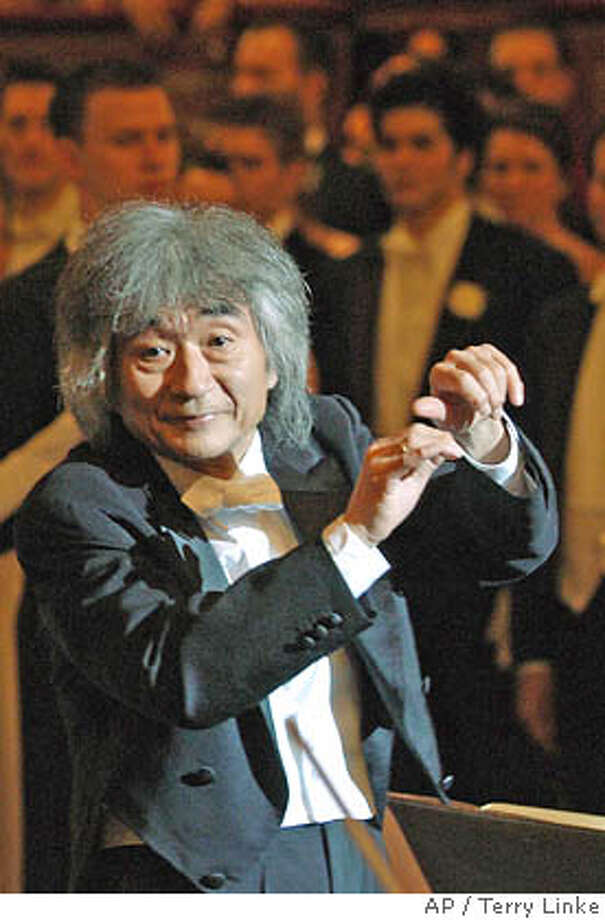 **FILE**Seiji Ozawa, music director of the Vienna State Opera, conducts on Jan.20, 2005,in Vienna, Austria. Ozawa's doctors have advised him to cancel all of his concerts planned for 2006 because he needs extended rest, the Vienna State Opera said Wednesday, Feb. 1, 2006. (AP Photo/Terry Linke) Ran on: 02-02-2006 Conductor Seiji Ozawa was hospitalized with a bronchial infection and shingles. A JAN 20 2005 FILE PHOTO Photo: TERRY LINKE