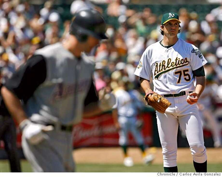 ATHLETICS03_001_CAG.JPG  Oakland starting pitcher, Barry Zito, turns away after walking Shawn Green with the bases loaded to give the Diamondbacks the go-ahead run in the top of the ninth inning. Chad Tracy scored from third on the play. The Oakland Athletics played the Arizona Diamondbacks at McAfee Coliseum on Sunday, July 2, 2006. Oakland lost the game 3-1, as the Diamondbacks swept the series in Oakland.  Photo by Carlos Avila Gonzalez/The San Francisco Chronicle  Photo taken on 7/2/06, in Oakland, Ca, USA  **All names cq (Roster) Photo: Carlos Avila Gonzalez