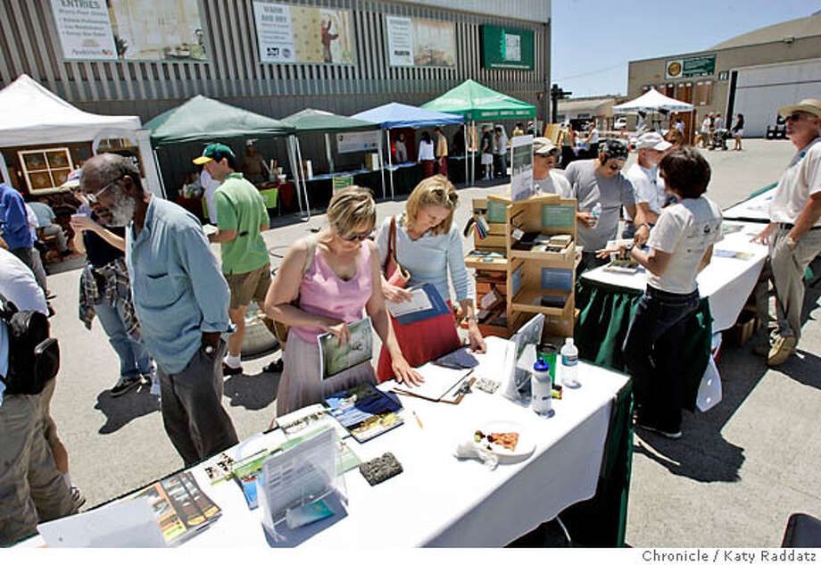 GREENWASH_007_RAD.JPG  SHOWN: A green building fair at Truitt & White Lumber in Berkeley--the two ladies in the foreground are, L to R: Susanne Keller of Saratoga, who wants to remodel her house, and Susan Luhrs of Los Altos who wants to build a green house in Germany. Story is about Green being The Next Big Thing in construction. Photo shot in Berkeley, CA. on Sunday, June 4, 2006. (Katy Raddatz/The Chronicle)  Photo taken on 6/4/06, in BERKELEY, CA.  **Susan Luhrs, Susanne Keller Photo: Katy Raddatz
