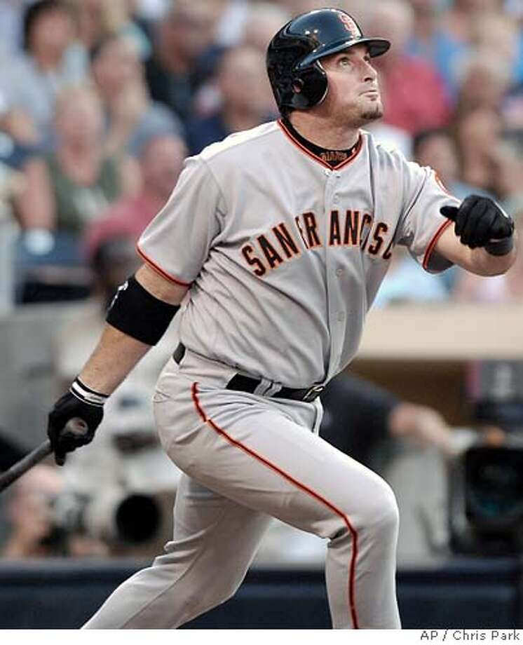 San Francisco Giants' Mark Sweeney watches the flight of his solo home run against the San Diego Padres in the second inning of their baseball game Saturday, July 1, 2006, in San Diego. The two runs tied the game. (AP Photo/Chris Park) Photo: CHRIS PARK