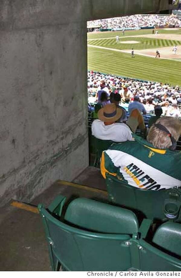 SEATS_007_CAG.JPG  Obstructed view seats in the left foul zone. The seat doesn't allow you to even see the batter. Photos for story on worst seats at A's and Giants games. Photo by Carlos Avila Gonzalez/The San Francisco Chronicle  Photo taken on 6/15/06, in Oakland, Ca, USA  **All names cq (source) MANDATORY CREDIT FOR PHOTOG AND SAN FRANCISCO CHRONICLE/ -MAGS OUT Photo: Carlos Avila Gonzalez