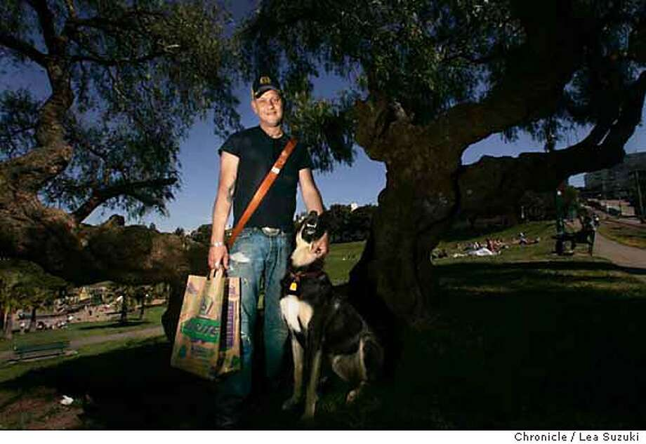 """onthetown_ray040_ls.jpg Rex Ray, with his dog Skeeter, next to a tree in Dolores Park on Monday, May 15, 2006 in San Francisco, CA. which is listed in his Style section """"On the Town"""" piece. For the Style section he has listed places that feed his creative vision around his Mission neighborhood. He lists a strange and beautiful pepper tree in Dolores Park. """"Almost every day at happy hour you can find me at Dolores Park's dog hill. It's the best place for some daily X-treme dog socializing. Near the very top of the park looking over the acacia, magnolia and eucalyptus trees stands a lone pepper tree. It's gnarled and aternately creepy and beautiful and looks as though it stepped out of a Japanese watercolor.""""  Rex Ray's abstract designs have graced David Bowie's CD covers and collectible Bill Graham Presents concert posters. W San Francisco has a permanent collection of his work as part of the hotel's White space series. Photo taken on 5/15/06 in San Francisco, CA. (Photo by Lea Suzuki/ The Chronicle) MANDATORY CREDIT FOR PHOTOG AND SF CHRONICLE/ -MAGS OUT. Photo: Lea Suzuki"""