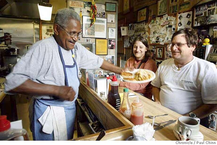 Jodie Royston (left) serves up one of his killer breakfasts to Marc Korchin (right) while Jennifer Susskind (center) waits for her meal at Jodie's Cafe in Albany, Calif. on Wednesday, June 28, 2006.  PAUL CHINN/The Chronicle  **Jodie Royston, Marc Korchin, Jennifer Susskind MANDATORY CREDIT FOR PHOTOGRAPHER AND S.F. CHRONICLE/ - MAGS OUT Photo: PAUL CHINN