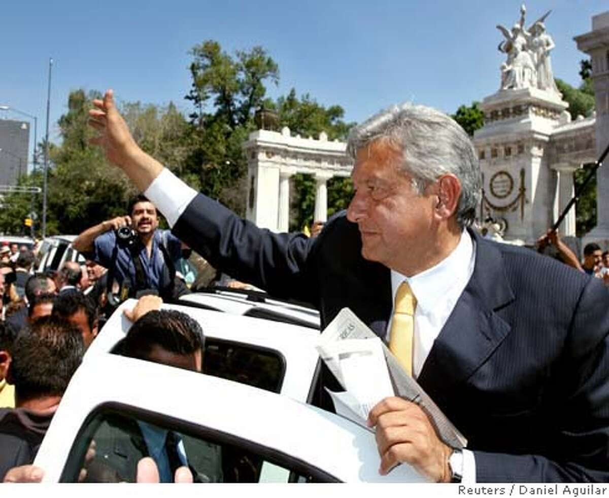 Lopez Obrador, presidential candidate of PRD, waves to supporters during rally in Mexico City
