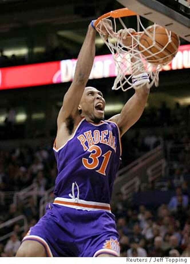 Phoenix Suns Shawn Marion scores against the Boston Celtics in NBA game action in Phoenix Photo: JEFF TOPPING