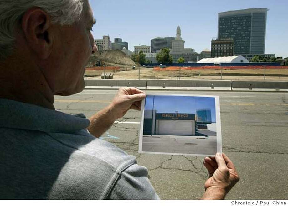 John Revelli holds up a photo of his former tire business when he visited the site in downtown Oakland, Calif. on Friday, June 23, 2006. The Oakland Redevelopment Agency took his business, which his family had owned since 1949, through eminent domain proceedings so a developer could construct a huge apartment complex.  PAUL CHINN/The Chronicle **John Revelli MANDATORY CREDIT FOR PHOTOGRAPHER AND S.F. CHRONICLE/ - MAGS OUT Photo: PAUL CHINN