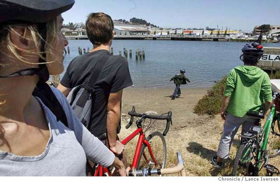BAYTRAIL_179.JPG  Chris Bailey (left) from San Francisco looks on as Ian Trevithick age 6 also from SF plays on the beach at Islais Landing. Several hundred bikers and Kayaker's took part in the Imagine The Way tour of the Baytrail between San Francisco's China Basin Park and India Basin Shoreline Park Saturday. The event launched the Blue Greenway Initiative, a 13-mile greenway/waterway network along San Francisco's Southern waterfront. . 6/24/06 in SAN FRANCISCO.  By Lance Iversen/San Francisco Chronicle MANDATORY CREDIT PHOTOG AND SAN FRANCISCO CHRONICLE/ MAGS OUT Photo: By Lance Iversen