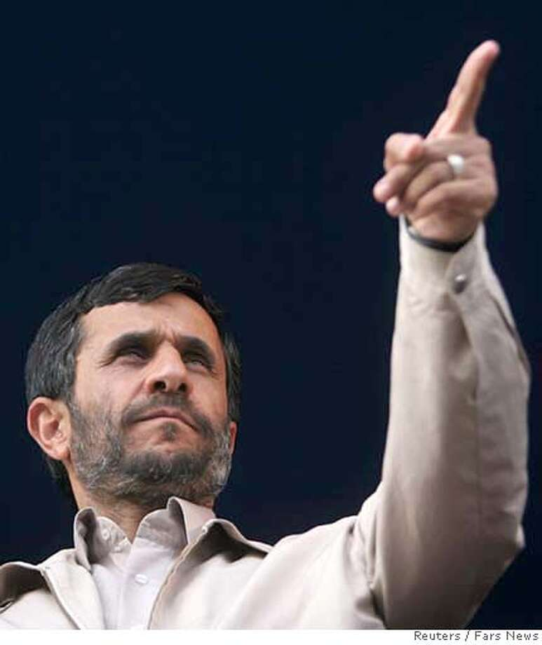 Iranian President Mahmoud Ahmadinejad gestures as he speaks to the people of Hamadan Photo: STRINGER/IRAN