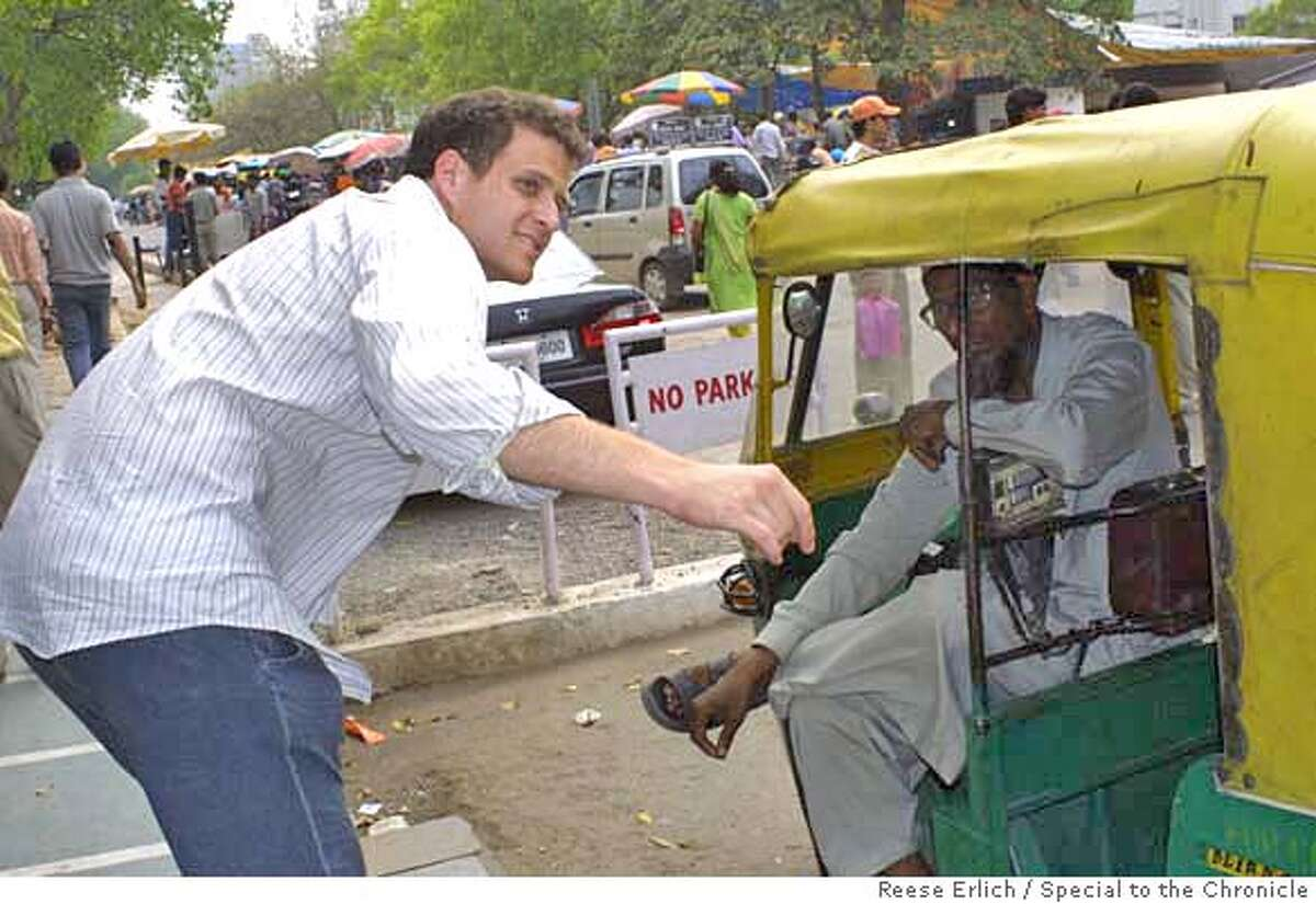Transport is cheap in India. Here, former California resident Erik Simonsen negotiates a fare with a New Delhi cab driver. Photo by Reese Erlich/Special to The Chronicle