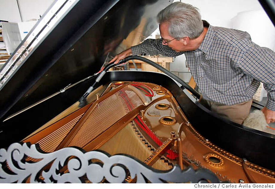 .JPG  John Callahan, owner of Callahan Piano, cleans off a Steinway grand piano that is about to be delivered to its owner after a year-long restoration in his Alameda, Ca., shop on Monday, June 12, 2006. Since 1957, Callahan Piano Service, a family owned and operated business in Alameda, Ca., has been providing the finest quality piano tuning, repairs and rebuilding to the San Francisco Bay Area and beyond. John Callahan, the owner/ operator of Callahan Piano Service since 1975, is a member of the Piano Technicians Guild and received the highest classification of Registered Piano Technician in 1978. Under his guidance, Callahan Piano Service has grown to be the largest piano service organization in the San Francisco Bay Area with over 6,000 customers including numerous churches, recording studios, recital halls, and musicians.  Photo by Carlos Avila Gonzalez/The San Francisco Chronicle  Photo taken on 6/12/06, in Alameda, Ca, USA MANDATORY CREDIT FOR PHOTOG AND SAN FRANCISCO CHRONICLE/ -MAGS OUT Photo: Carlos Avila Gonzalez